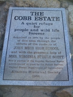 "Cobb Estates historical trail sign created by the Altadena Historical Society in 1988. It says the following: ""THE COBB ESTATES A quite refuge for people and wild life forever.  Aquired in 1971 by the people of this area through the efforts of the students of JOHN MUIR HIGH SCHOOL and with the generous help of MRS. VIRGINIA STEELE SCOTT  Now a portion of the Angeles National Forest administered in the trust by the Forest Service.  United States Department of Agriculture Altadena Historical Society 1988."""